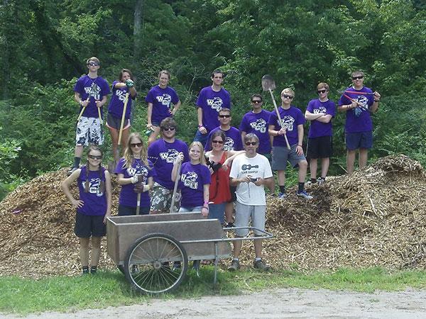 volunteers cleaning river